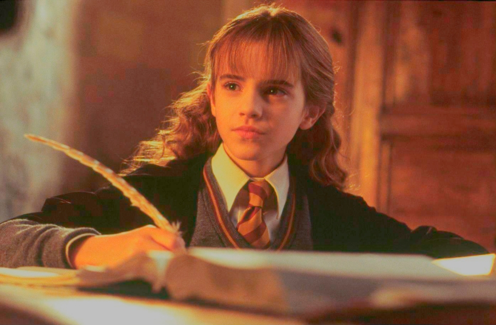 094546ef-ea4c-4e64-a625-4cc8d23ee35c-young-hermione-with-quill